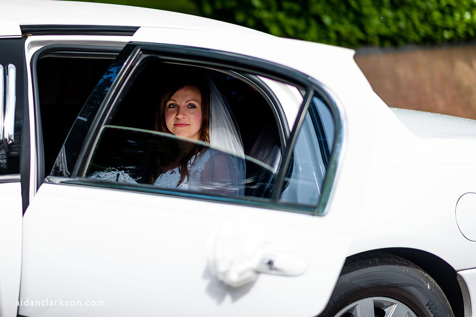 Bride getting out of the car for her church wedding